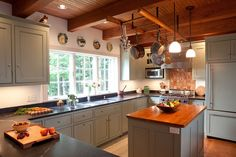 Early American Post & Beam Kitchen by Yankee Barn Homes, via Flickr like the ladder pot rack