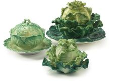 A group of three porcelain cabbage tureens and covers19th century