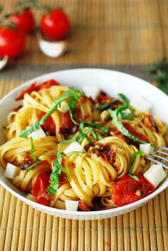 Fettuccine with Goat Cheese, Bacon, and Cherry Tomatoes from A Duck's Oven.