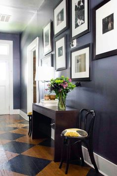 Before & After: A Cozy and Sophisticated Bungalow for Dad | Design*Sponge...Because it is the first room guests would see, Kevin wanted the entry to make a bold statement with his dad's photographs lining the wall.