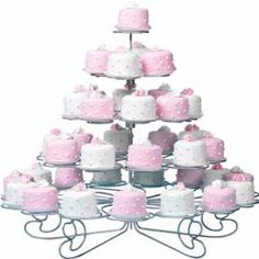 Instructions:  Bake and cool 1 1/2 in. high cake in sheet pan. Cut individual circles. Position cakes on cooling grid over waxed paper. Heat canned icing in microwave at Defrost setting for 20-30 seconds; stir. Tint a portion of icing rose. Place cooled cakes on cooling grid. Pour icing in center of cake, spreading to edges with a spatula so that icing covers sides. Let dry.