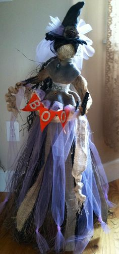 My witch I made using tattered angels sprays and paint and canvas corp burlap and banners