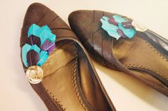 Feather Shoe Clips. I have tons of ballet flats that could use a little somethin' like this.