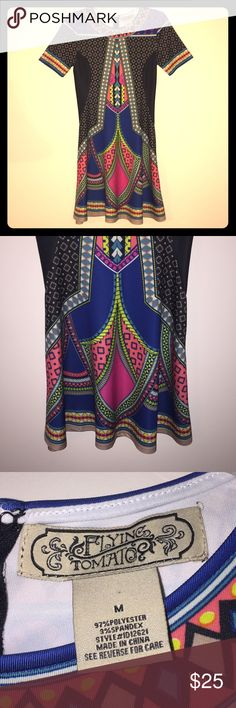 Boutique Colorful Pattern Dress This dress is super comfy and is in excellent condition! It was only worn once and is made mostly with polyester with a little spandex so it is slightly stretchy, has a slight flare at the bottom, is multicolored with a variety of patterns. Flying Tomato Dresses Midi