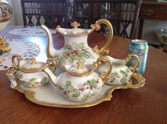 WoW, a Beautiful TV Limoges Tea and Coffee set Hand Painted! One Coffee pot, One Tea pot, Creamer & Sugar 17.5 by 12 Tray. This set is in unused excellent condition! Good luck bidding!