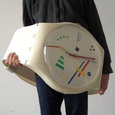 NIKOLAI VASILY Swatch Maxi PUBLISHER: SWATCH  MATERIAL: Plastic DIMENSIONS: 210 cm long / Clock Face Diameter 27 cm RELEASED: 1987  CONDITION: