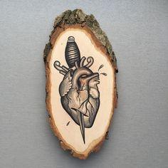 Wood slice with original drawing of an anatomical door Inkspirednl
