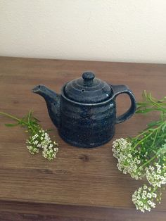 A personal favorite from my Etsy shop https://www.etsy.com/listing/384445472/dark-blue-ceramic-teapot-with-diffuser