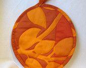Orange you glad you looked at the shades of Orange Marimekko  pot holder/hot pad