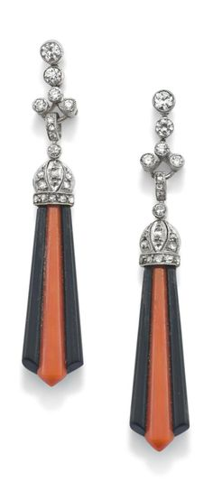 A pair of Art Deco coral and onyx pendants. Each designed as fan-shaped drops composed of a tapered flute of onyx inset with coral, to a rose-cut diamond cap and articulated circular-cut diamond surmount, length 5.2 cm, post fittings. #ArtDeco