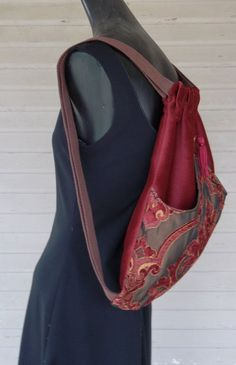 Original handmade backpack made with dark rust velvet. The outside pocket is of shades of rust to burgundy and iridescent brown with tapestry fabric arches in the middle and sewn at the point. This outside pocket is lined with satin. The bag itself is serged on the inside and measures 14 x 18.  The tassel is burgundy.  This backpack is great with that outside pocket for stashing your water or book. Makes it great for on the go girls.