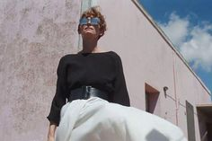 Why Tilda Swinton Should Be Your Summer Style Guru #refinery29 http://www.refinery29.com/film-summer-a-bigger-splash-style#slide-4 Swinton's dramatic look of a black blouse and billowing white skirt, cinched by a thick leather belt, is proof that style on holiday doesn't have to be a compromise....