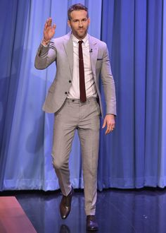 Ryan Reynolds' 11 Best Double Take Outfits Photos | GQ -- dove grey suit, color knit tie, chocolate oxfords