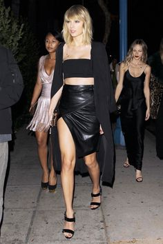 The pop star showed off her killer body in an ab-baring crop top and skirt on Sunday night.
