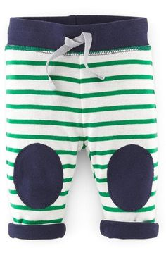 Free shipping and returns on Mini Boden Reversible Knee Patch Pants (Baby Boys) at Nordstrom.com. A wide-ribbed waistband, knee patches and cuffs provide a pop of contrast color on striped pants shaped from soft cotton jersey.