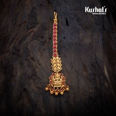 Historic Antique Lakshmi Tikka studded with Ruby Green synthetic stones, with Gold Polish.