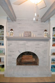 Beach House Remodel, painting a brick fireplace. Gray-Wash: Whitewash with a twist!