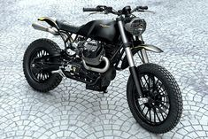 "Meet the Moto Studio ""Braapster"", an urban scrambler take on a Moto Guzzi Roamer. A reflection of Miami architecture, this is one custom that won't be forgotten. Scrambler Moto, Moto Guzzi Motorcycles, Cool Motorcycles, V9 Roamer, Guzzi V9, Cx 500, Moto Cafe, Cruiser Motorcycle, Bobber Motorcycle"