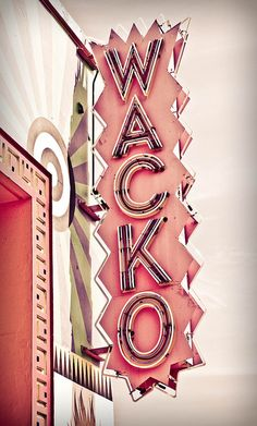 wacko sign! not only is it pink, but it's such an awesome design, including the building it's attached to!!!! I LOVE IT!!