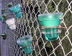Use wire to attach pots (and other things, like these candles) to a chain link fence