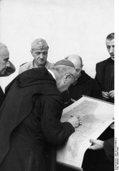 Gregorio Diamare and the ecclesiastical authorities of Monte Cassino abbey giving German Luftwaffe troops the permission to remove artwork for transfer to Germany, 4 January 1944 (German Federal Archive, photographer: Meister)