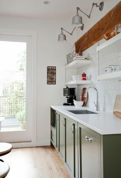 Green kitchen cabinets & suspended shelving