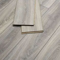 Distressed Grey Oak offers the eye-catching features of a reclaimed and hand-finished solid wood floor in the convenient format of laminate flooring. A great solution to add visual impact to a room and create a focal point. Laminate Flooring Colors, Oak Hardwood Flooring, Engineered Wood Floors, Grey Flooring, Bedroom Flooring, Kitchen Flooring, Luxury Vinyl Click Flooring, Conservatory Flooring, Grey Oak