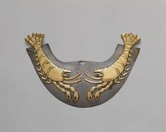 Nose ornament with Shrimp, 390-450 A.D. Peru, Moche culture. Gold, silver, stone. The Metropolitan Museum of Art, New York. The Michael C. Rockefeller Memorial Collection, Bequest of Nelson A. Rockefeller, 1979 (1979.206.1236)