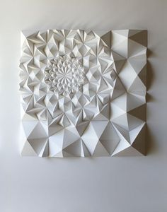 Matt Shlian - Beginning with an initial fold, a single action causes a transfer of energy to subsequent folds, which ultimately manifest in drawings and three dimensional forms.