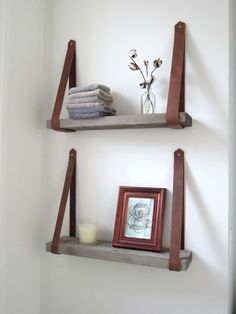 Shelving made from wood beams and leather straps. Simple and chic! great re-use from old belts