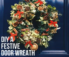 A DIY festive door wreath for Christmas. Home made with dried hydrangeas, fir cones, orange slices, red ribbon, cinnamon sticks and berries.