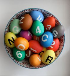 Personalized, monogrammed Easter eggs using stickers before dipping the eggs in dye.