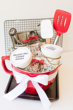 Red and White Cookie Basket - 20 DIY Christmas Gifts Anyone Would Be Excited to Open  - Southernliving. A perfect gift for the cook and cookie lover in your life, you can mix and match your favorite baking essentials to make this basket your own. Get the full tutorial here.