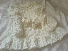 A Beautiful knitting pattern to make a 4 piece Christening set for a Reborn Doll size 18-20 inches in height or a Baby 0-3 months, the pattern comprises Dress, Bonnet, Bootees, Bottle cover. I have made this set in 4 ply cotton, but can be made in any 4 ply yarn, please visit my website www.kadiejadeknittingdesigns.com