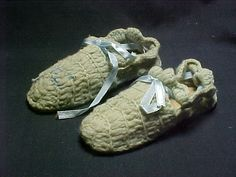 This is a pair of children's slippers from the McKinley Presidential Library & Museum's collection that was crocheted by Ida McKinley. Of the estimated 4000 pairs she made, the museum has 10 pairs in its collection (plus a single slipper that lost its mate before it was donated to us!).  We would love to know how many other pairs of her slippers are out there!