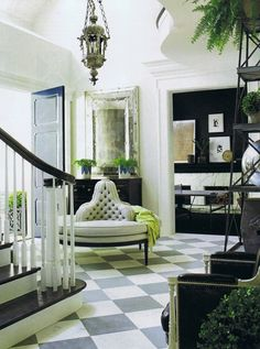 Adore the round chair in the entry and the antiqued mirror.