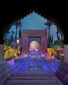 The sun setting in a pretty Moroccan patio. Beautiful colors.