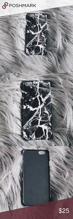 Brandy Melville Black Marble iPhone 6 (7) Case Brandy Melville Black Marble iPhone 6 Hard Plastic Case. Lightly used, like new. Gorgeous scratch resistant marble lightening design outside, matte black interior. Likely compatible with iPhone 7 - please inspect grooves on sides for button placement compatibility. Design has open bottom for compatibility of audio ports between phones. Brandy Melville Accessories Phone Cases