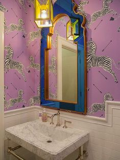 purple Scalamandre zebra paper with cobalt and gold mirror via The Zhush: Five Perfect Powder Rooms