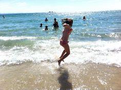 Wategos beach Byron bay..my beautiful girl frolicking.