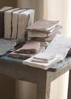 Rustic handmade journals....looks like handmade paper as well...love the subtle embossed image on the covers.