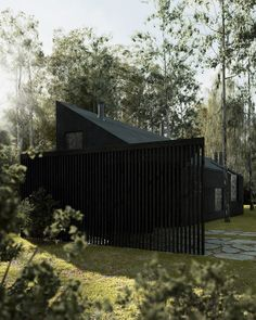 polish practice też architekci has designed an all-black house to be built amid the trunks of a forest of birch trees.
