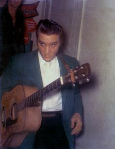Elvis heading for the stage at the Armory in Tampa, FL - Aug. 5, 1956