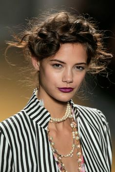 I may steal Nicole Miller's Sprin/Summer 2014 makeup look. Not sure about the wack-a-doodle milkmaid hairdo.