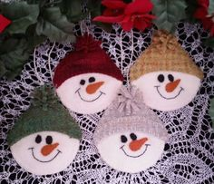 Snow Face Ornament Cath's Pennies Designs.  These little guys match the Snow Faces candle mat. So quick and easy to stitch these!