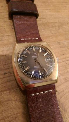 Tissot Seastar Automatic, Gold case, Brown dial.
