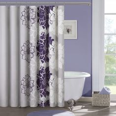 Constructed out of solid cotton for a soft texture, this floral shower curtain will effectively brighten up your bathroom. With a violet-purple pattern for a bold look, this elegant shower curtain is machine washable to ensure an easy cleaning process.