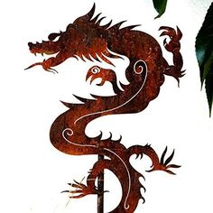 """Garden Art -Metal Chinese Dragon Stake. Metal Chinese Dragon Stake 32"""" X 6"""" The dragon is a traditional Chinese symbol representing growth, protection, vitality, prosperity, health, and new beginnings. This striking Dragon garden stake makes a powerful impression in gardens, pots, or planter boxes. It is made of steel and beautifully rusted for a dramatic presentation. All items listed here are uncoated. Thanks for looking at my art! Brett Cleveland 360-820-3189 brett@redgrassdesigns.com."""