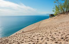 A truly incredible gem hidden in Middle America, Michigan's Sleeping Bear Dunes National Lakeshore offers a diverse area of woods, beaches, and fields, not to mention incredible sand dunes that give the place its name. The incredibly picturesque camping areas overlook the sloping dunes and sea-sized Lake Michigan. For extra adventure points, bring a kayak and go a paddle at sunrise.