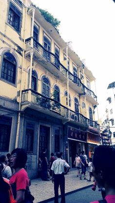 A vintage building on the crowded street of Macau
